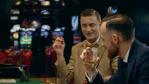 Men gamblers talking in a casino