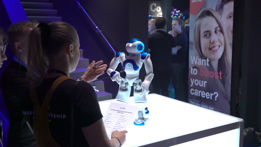 HELSINKI, FINLAND - NOVEMBER 30, 2017: Talking robot Nao autonomous, programmable humanoid robot by Aldebaran Robotics. Startup and tech event Slush in Messukeskus Expo center. Non-profit event for
