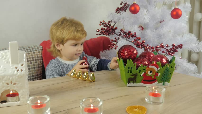 Christmas tale. Cute child plays with toys and fabulous golden birds. Faith in good and fairy tale, hope for the best in new year. Make a wish