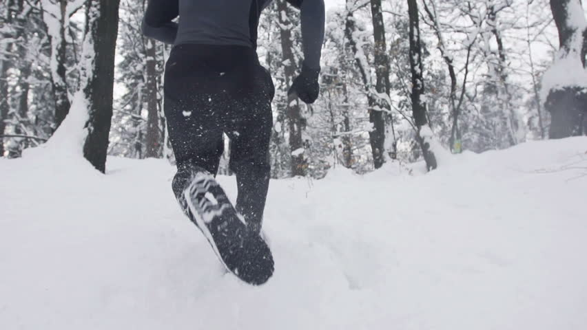 Slow Motion Of Young Sportsman Running Through Snowy Forrest. Shot In The Back. | Shutterstock HD Video #3387002