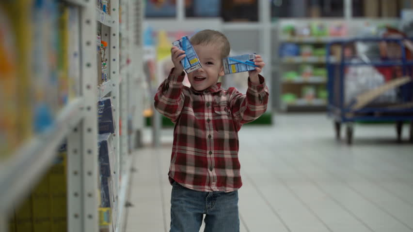 Child buys baby food in a store or supermarket | Shutterstock HD Video #33894982