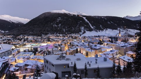 DAVOS, SWITZERLAND city night timelapse in winter of the city and jakobshorn. Winter ski sports resort and home of the WORLD ECONOMIC FORUM