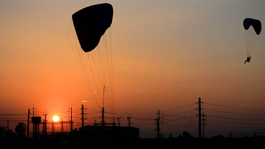 paramotor flying on sunset time