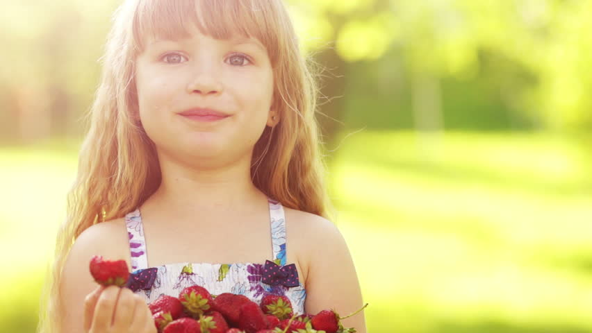 Child running with balloons in the park girl looking at camera laughing child eating strawberries 2 hd stock footage clip altavistaventures Image collections