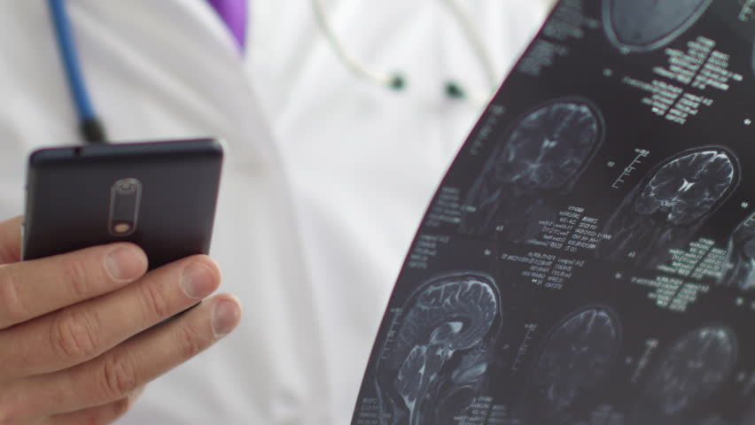 Medical doctor radiologist view MRI scan and typing SMS to somebody. 4K UltraHD video   Shutterstock HD Video #33960172