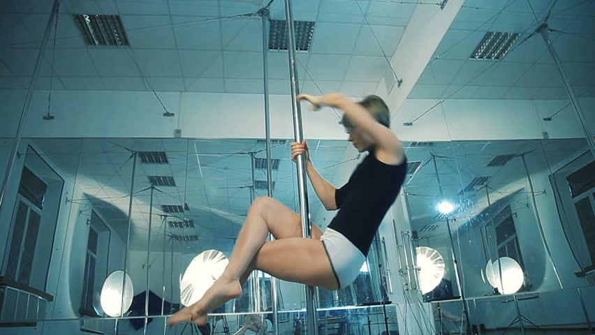 Girl dancing on a pole, dancer, fitness and sport. Pole Dance