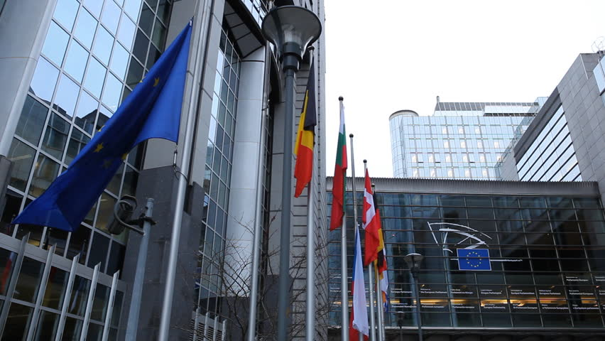 BRUSSELS, BELGIUM - DECEMBER 20: Flags in front of European Parliament Building in Brussels, Belgium on December 20, 2011.