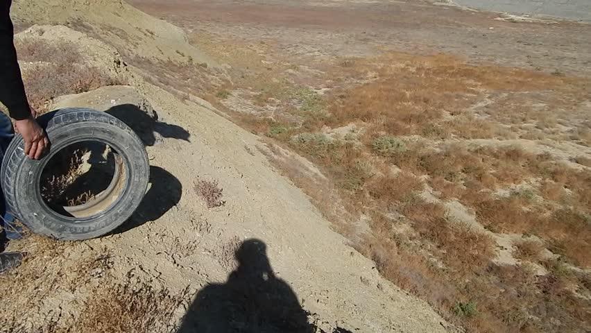 Uranium pit. Abandoned uranium quarry. Mangistau region. Kazakhstan. Wheel rolls down.