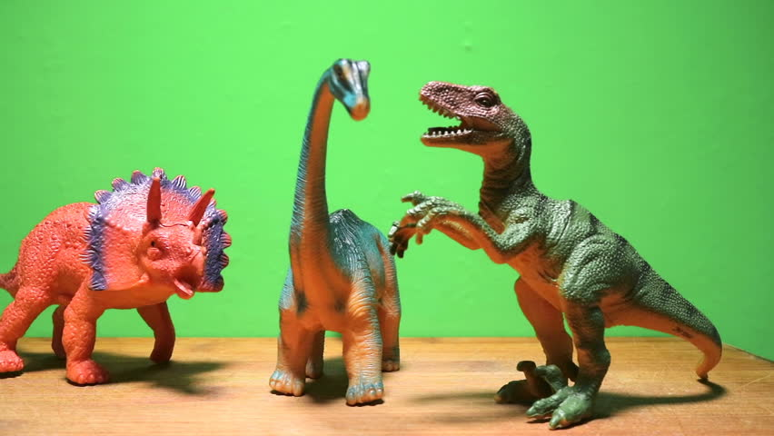Dinosaurs of the Jurassic period close-up on a green background. Herbivores and predators. Tyrannosaurus, triceratops and diplodocus.