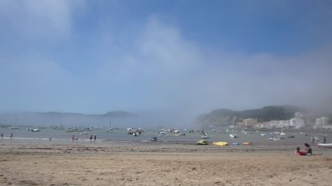Mist descends on the beach of Sao Martinho do Porto in Portugal in summer