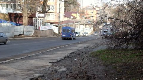 The road and part of the sidewalk with passing cars (Vinnitsa, Sverdlova St.)