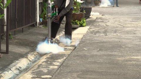 Man carries out fogging at village for anti-mosquito plan. Anti Zika virus