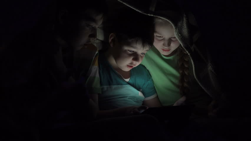 Boys and girl playing in the tablet under the covers   Shutterstock HD Video #34155562