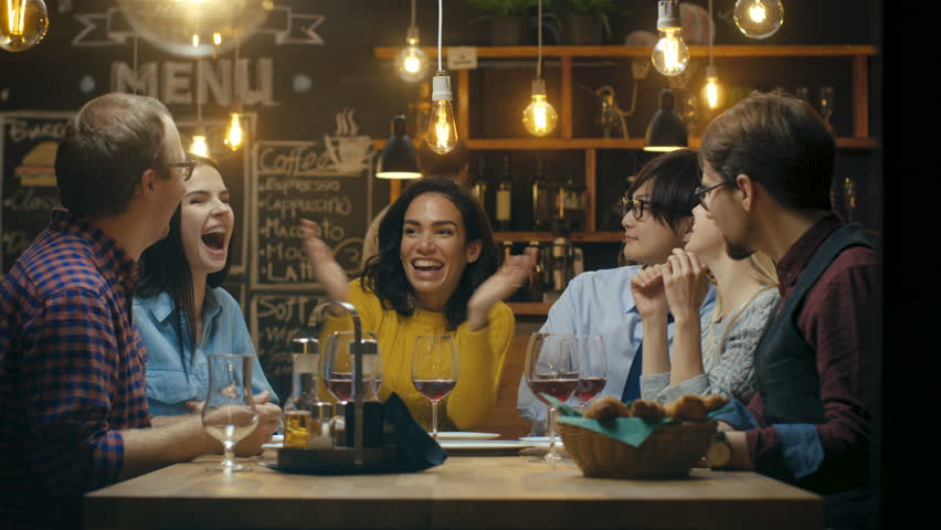 In the Bar/ Restaurant Beautiful Hispanic Woman Shares Good News with Her Dear Friends They Congratulate Her Heartily and Applaud. They Sit in the Stylish Hipster Establishment.  #34161202