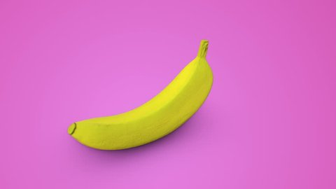 Seamless rotation of a yellow banana on a pink background