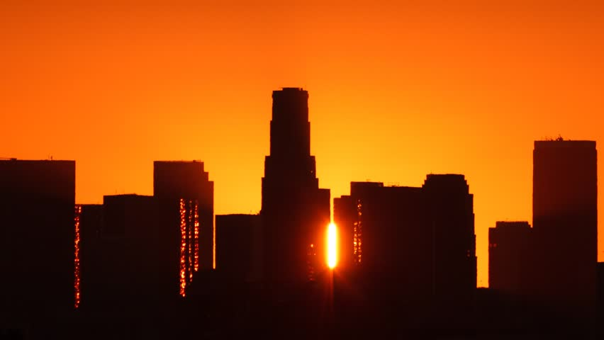 Los Angeles skyline sunrise. Pan and zoom out. Timelapse. Silhouette with Flare.