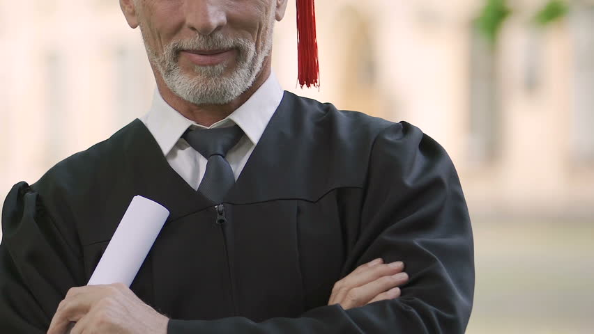 Mature man proud of receiving high school diploma, postgraduate education | Shutterstock HD Video #34217422