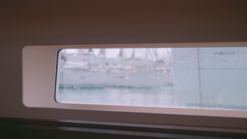 View of yachts in marine in Majorca through side scuttle saloon of yacht   Shutterstock HD Video #34222852