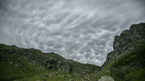 Lumpy, bumpy mammas or mammatus clouds. Mountain summer landscape.