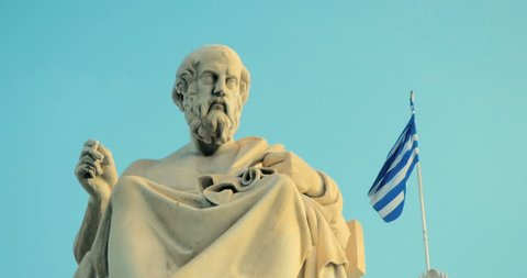 Marble statue of the Greek philosopher Plato background of Greek architecture in slow motion.