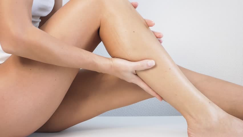 Woman with perfect body applying refreshing cream or body lotion on her legs, Concept depilation, skincare, cosmetics | Shutterstock HD Video #34275322