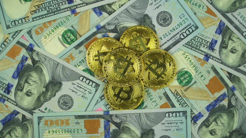 Gold Bit Coin Btc Coins Rotating On Bills Of 100 Dollars Worldwide Virtual Internet Cryptocurrency And Digital Payment System Money Crypto