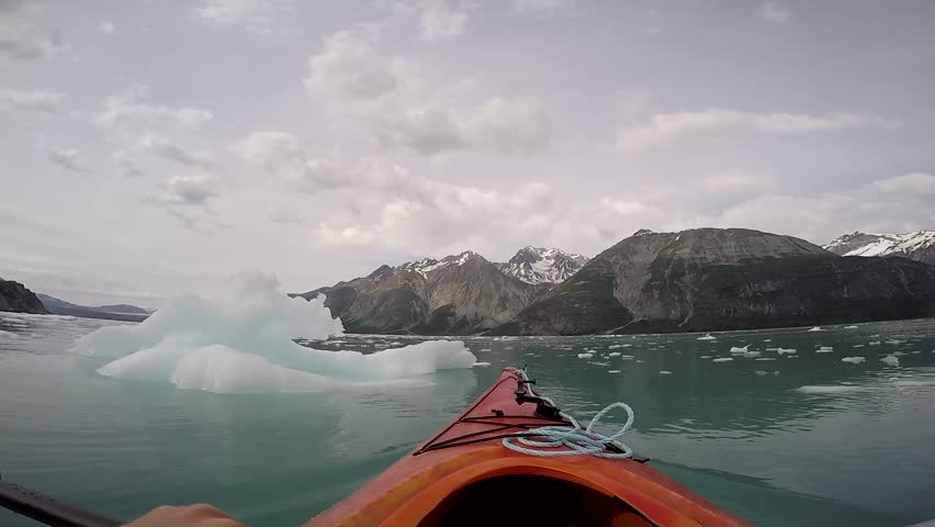 A lone Kayak approaching an iceberg in Glacier Bay National Park, Alaska.  | Shutterstock HD Video #34328032