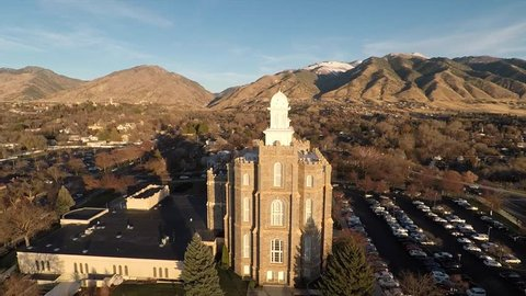 flying a circle around a mormon temple at sunset in Logan Utah