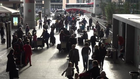 MALAGA, SPAIN - DECEMBER 23, 2017: Passengers at Malaga Airport in Spain exiting a terminal building