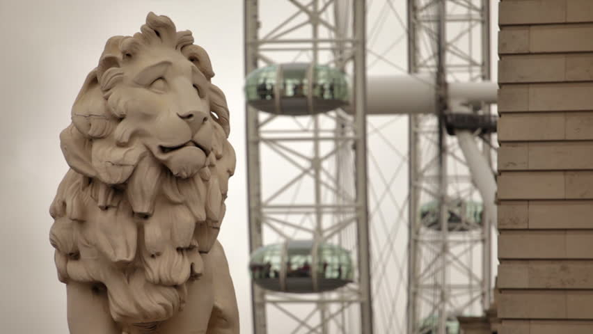 South Bank Lion on Westminster Bridge with London Eye in Background, located in