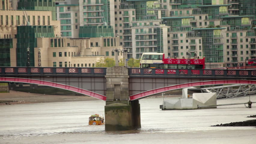 A shot of Lambeth Bridge with cars and buses going across it in London, England