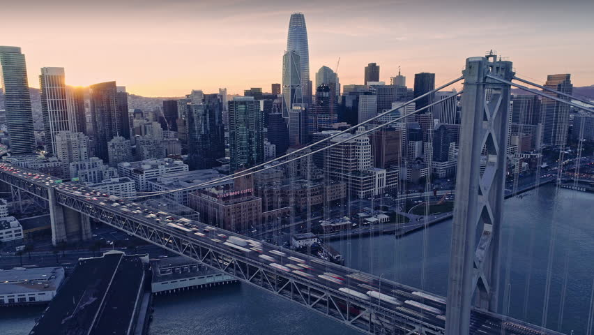 Aerial Time Lapse: San Francisco Embarcadero, Ferry Building, bay bridge & cityscape at night.