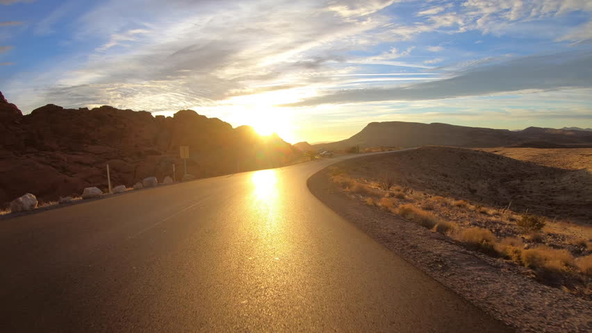 Red Rock Canyon scenic loop road sunrise rear view driving in the Mojave desert near Las Vegas, Nevada.   | Shutterstock HD Video #34423282