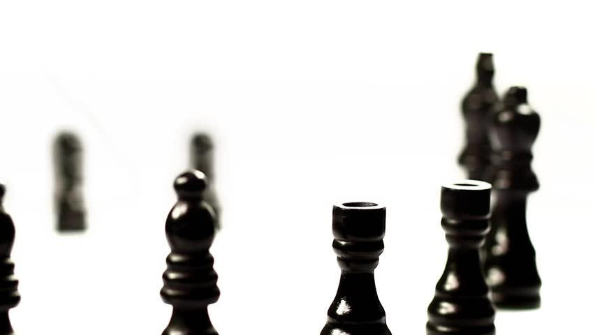 Chess set's march. Black chess pieces crossing in a row.
