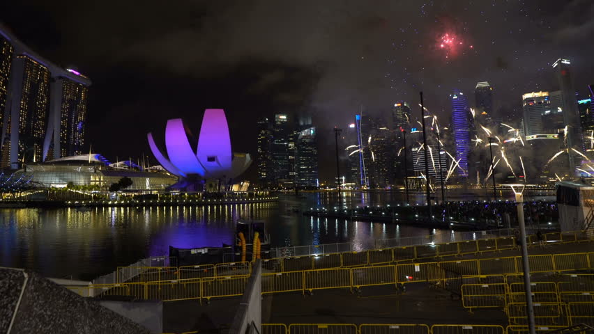 Marina Bay, Singapore - January 01, 2018: HD b-roll cinematic footage of new year eve 2018 fireworks show at Marina Bay, Singapore. Tilt up | Shutterstock HD Video #34441132
