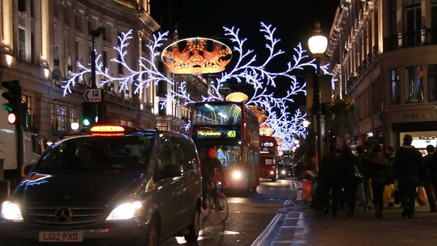 LONDON, UK - DECEMBER 27: Buses and cars drive through Regent Street under the Christmas lights on December 27, 2012 in London, UK. Regent Street is a famous shopping street in London