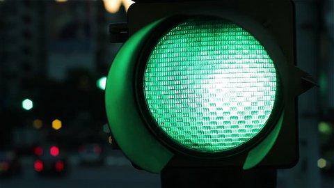 Green Traffic Light Signal at Night. Close-Up.