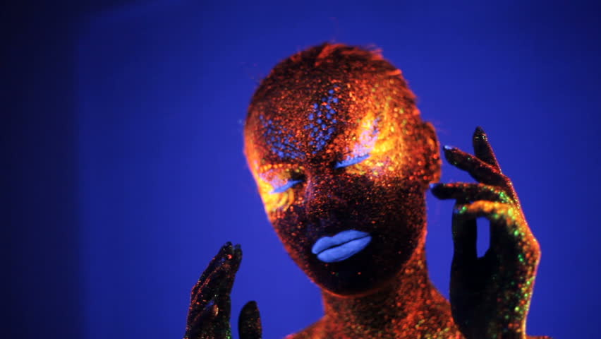 Girl dancing in the ultraviolet light