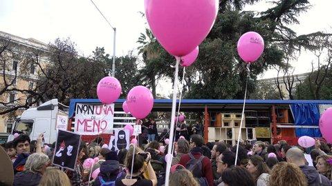 "pink ballons, people ""Nouna meno"" on the street- Milan, Italy,25 November 2017,"