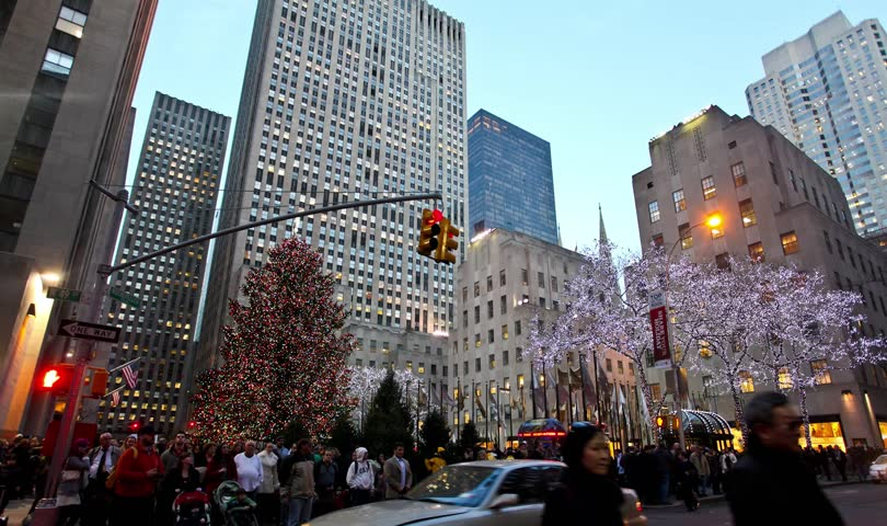 NEW YORK - DECEMBER 22, 2011: Time Lapse of tourist walking under and around the great Christmas Tree in Rockefeller Center in New York City