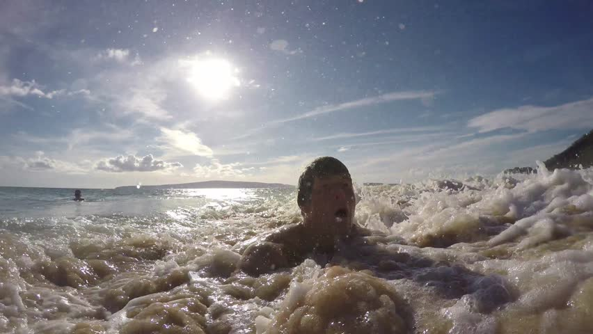 Selfie Of Solo Man Playing In Waves At A Tropical Beach | Shutterstock HD Video #34584832