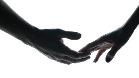 close up - Lovely couple holding hands on white background, the silhouette of the hands men and women gently touching each other