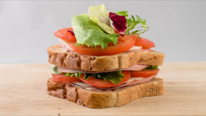 making sandwich with tomato, ham, cheese and salad stop motion. preparing snack