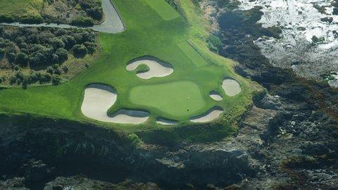 Aerial view Pebble Beach golf course 7th hole Arrowhead Point rocky coastline Carmel Big Sur California USA RED WEAPON