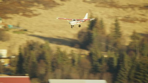 Aerial view of small Cessna flying plane coming into land Alaska USA
