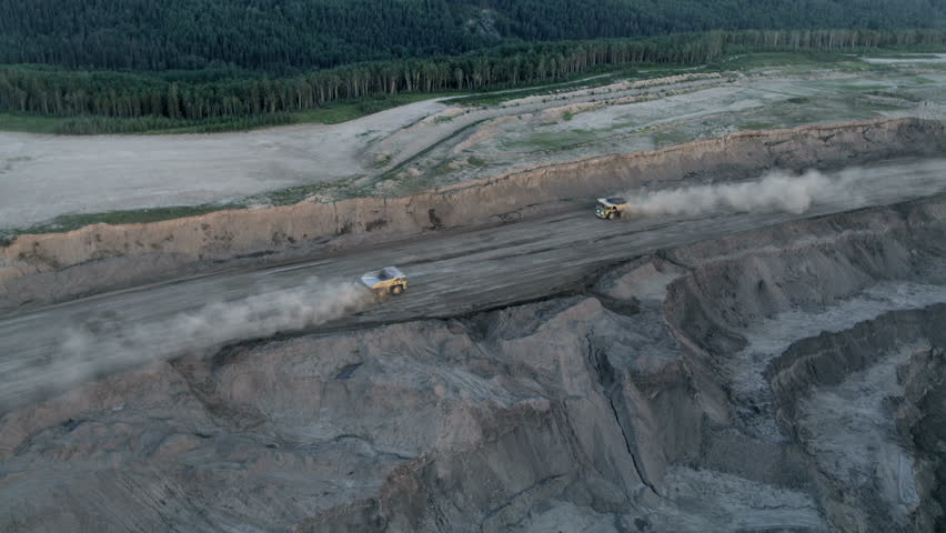 Aerial view of mining in the Athabasca tar sands region which consist of a surface tailings pond of chemical residue Fort McMurray Alberta Canada RED WEAPON