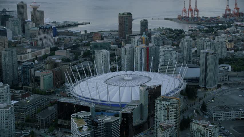 Vancouver Canada - Sept 2017: Aerial view BC Place events stadium downtown Vancouver skyscrapers and Vancouver Harbour container shipping port British Columbia Canada RED WEAPON