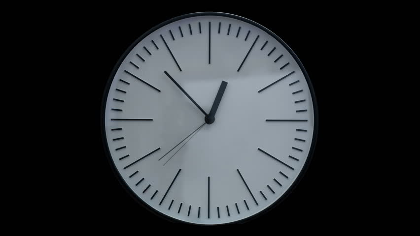 Time lapse shot of a modern clock on black background