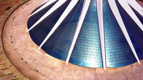 Aerial drone shot flying over top the Cathedral of Brasilia