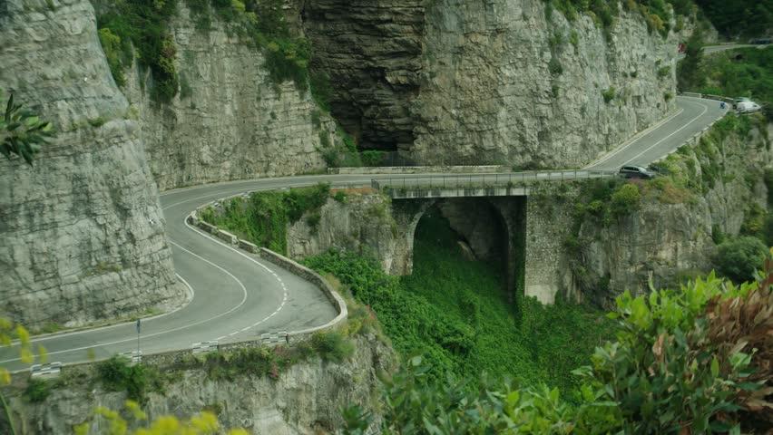 Car driving along a road on the Amalfi Coast
